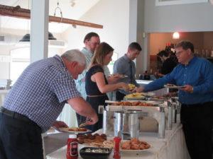 Attendees Getting Breakfast